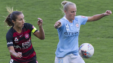 Touch and go: Servet Uzunlar of the Wanderers and Tameka Butt of Melbourne City.