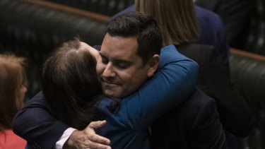 Independent MP Alex Greenwich is congratulated by Liberal MP Felicity Wilson after the passing of the bill to decriminalise abortion.