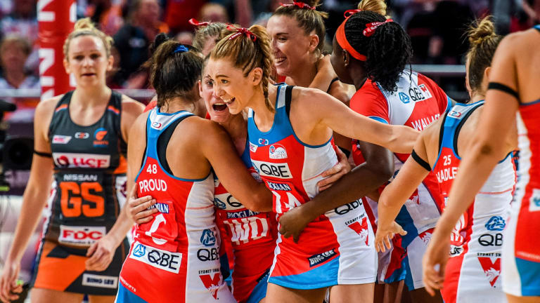 The Swifts celebrate after downing the Giants.