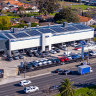 Big car yards cash in as housing drives up values
