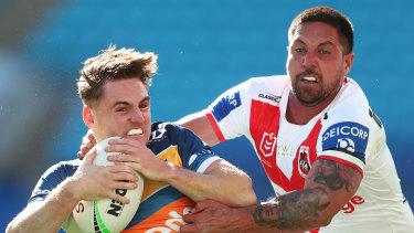 Gold Coast's AJ Brimson tries to escape the Dragons' Gerard Beale.
