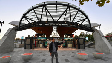 A commuter snaps a selfie outside Hills Showground station on the new Metro Northwest line.
