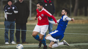 Canberra FC's Aidan Brunskill, and Canberra Olympic's Josh Calabria.