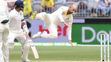 Up there: Nathan Lyon goes flying in a bid to reach a catching opportunity.