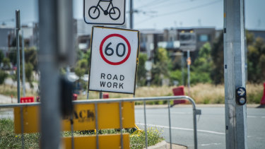 Only a 60km/h speed limit sign remains visible on Flemington Road, near the intersection with Well Station Drive.