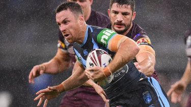 James Maloney charges through the driving rain on his return to the Blues in Perth.