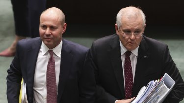 Treasurer Josh Frydenberg and Prime Minister Scott Morrison depart after Question Time at Parliament House in Canberra on Wednesday.