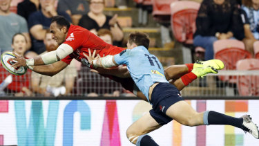 Full flight: Semisi Masirewa scores one of his two tries for the Sunwolves against the Waratahs last season.
