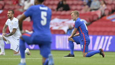 Fans booed: England's and Romania's players take a knee before the international friendly match in Middlesbrough.