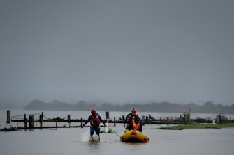 A SES crew make their way through the flood waters in Shoalhaven Heads in August this year.