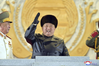 Kim Jong Un, at the parade Thursday night, is keen to display a show of strength as the Biden administration takes power in the US.