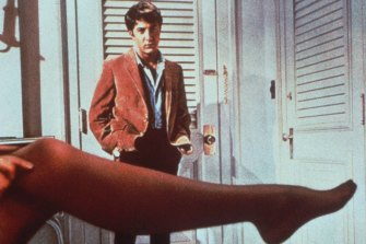 Dustin Hoffman looks over the leg of Anne Bancroft in The Graduate.