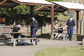 NSW Police patrol Bondi Beach as the city goes into a 14-day lockdown.