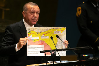 "Turkish President Erdogan with his ""safe zone"" map at the UN in September."