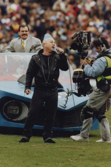Angry Anderson with the Batmobile at the 1991 grand final.