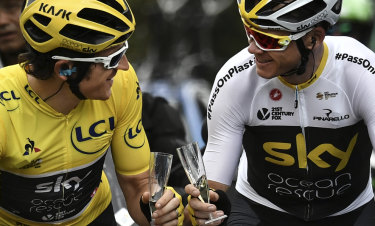 Team Sky's Geraint Thomas and teammate Chris Froome on their way to Paris on Sunday.