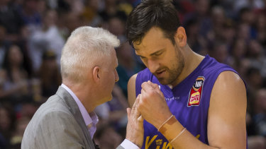 Not the finest start: Andrew Gaze gives Andrew Bogut a consolation pat as he heads to the bench.