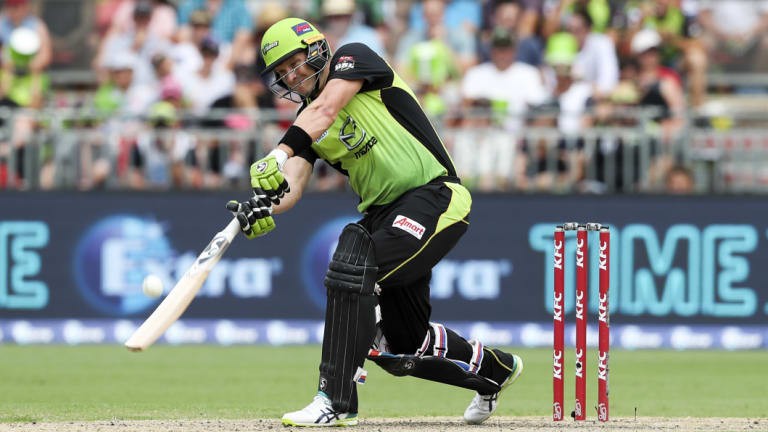 Swinging for the fences: Shane Watson goes over the top against the Strikers at Spotless Stadium.