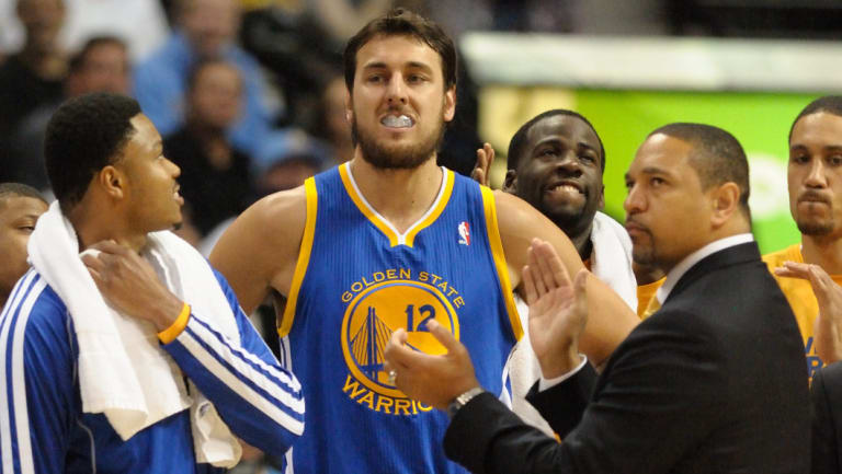 Aussie connection: Jackson (second right) coached Andrew Bogut and the Warriors before going into broadcasting.