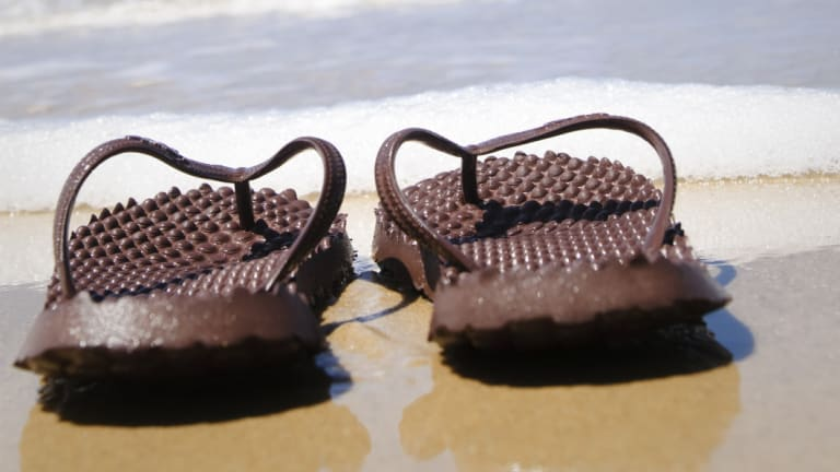 Hundreds of thongs will be distributed in remote communities to give to any passengers on flights who need shoes.