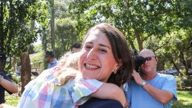Premier Gladys Berejiklian celebrates in her electorate, Willoughby, on Sunday.