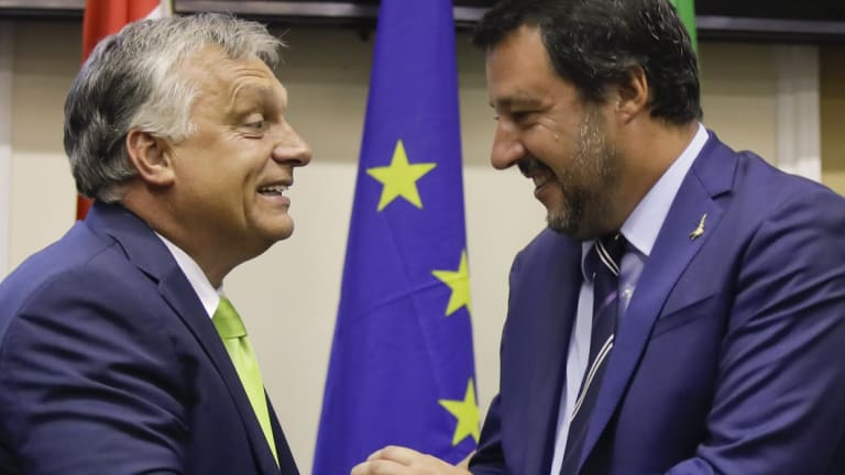 Italy's Interior Minister and Deputy-Premier Matteo Salvini, right, shakes hand with Hungary's Prime Minister Viktor Orban after their meeting in Milan, Italy.
