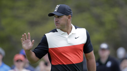 Koepka leads, Tiger struggles in PGA Championship first round
