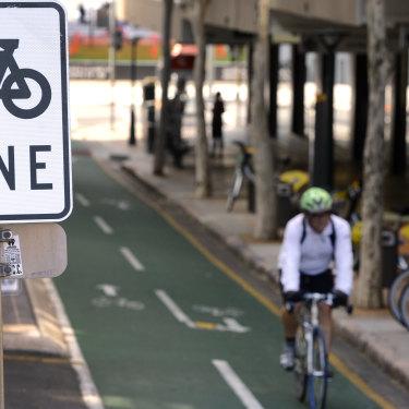 A cyclist rides his bike on a bike lane in Brisbane.