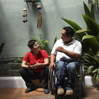 Peters with Alex Gálvez, one of the founders of Asociación Transiciones, a grassroots charity that salvages wheelchairs and gives them to the victims of gun violence.