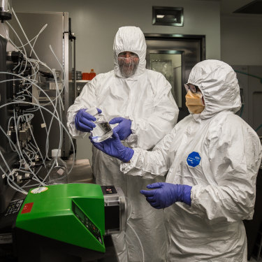 Professor George Lovrecz and Mylinh La at CSIRO's manufacturing facility for a pilot coronavirus vaccine in Clayton, Melbourne.