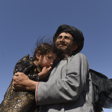 Abdul Haq and his four-year-old daughter Khadija.