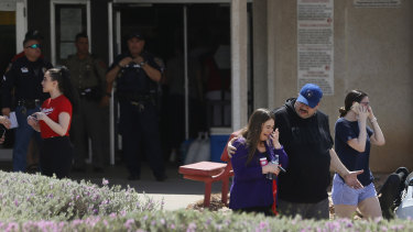 People arrive at MacArthur Elementary looking for family and friends as the school is being used a re-unification centre during the aftermath of a shooting at the Walmart in El Paso, Texas.