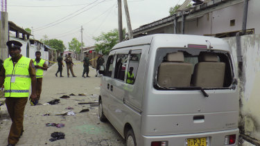 Sri Lankan police and army soldiers secure the site after an explosion and a gunbattle in Kalmunai, eastern Sri Lanka.