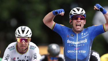 Mark Cavendish celebrates after winning the fourth stage of the Tour de France.