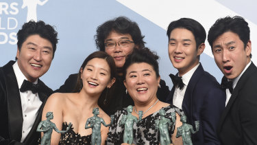 Kang-Ho Song, from left, Park So-dam, Bong Joon-ho, Jang Hye-jin, Choi Woo-shik, and Lee Sun Gyun of <i> Parasite </i>.