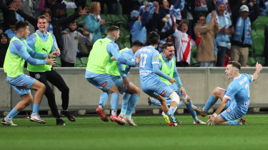 Scott Galloway celebrates after City's third in injury time.