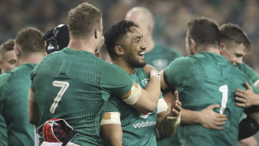 Changing of the guard: Josh van der Flier and Ireland's Kiwi-born Bundee Aki embrace after beating the All Blacks.