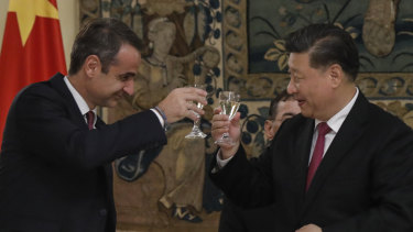 Chinese President Xi Jinping, right, and Greek Prime Minister Kyriakos Mitsotakis toast during a state dinner at the Greek presidential palace in Athens.