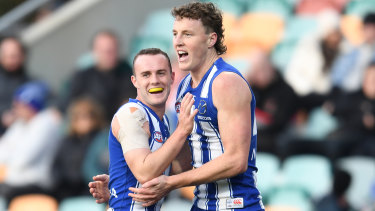 Jack Mahony and Nick Larkey celebrate a goal for the Roos.