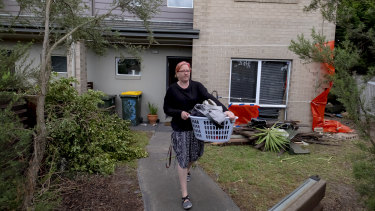 Sarah Burgess leaves her Seaford home after a car crashed into her lounge room.