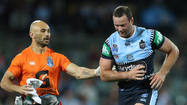 Boyd Cordner is assisted from the field after suffering a head knock in the opening State of Origin clash in 2020.
