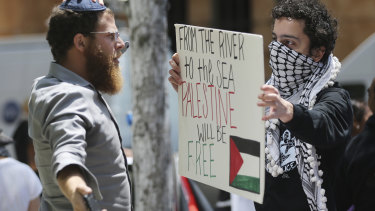 A man wearing a yarmulke, left, confronts one of about two dozen demonstrators protesting the US embassy move on Monday.
