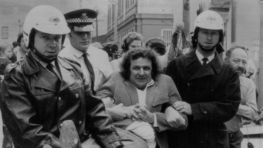 Jack Mundey is carried away from a protest in October, 1973.