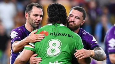 Cameron Smith and Jesse Bromwich acknowledge the performance of Josh Papalii.