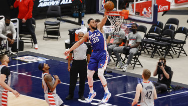 The Philadelphia 76ers' Ben Simmons soars for a dunk in game four of the first round playoff series against the Wizards.