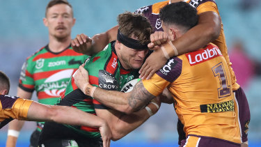 The Rabbitohs' Liam Knight is tackled by Darius Boyd.