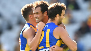 Brendon Ah Chee celebrates a goal with his West Coast teammates at the MCG.