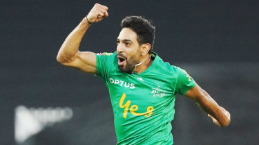 Triple treat: Haris Rauf celebrates after claiming a hatrick for the Melbourne Stars at the MCG.