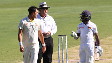 Blunted: Sri Lankan batsman Niroshan Dickwella and the out-of-sorts Mitchell Starc have words during day three.
