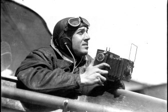 Herald Melbourne photographer takings snaps during air search. April 4, 1931.